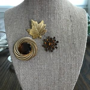 Gold and Amber Brooches